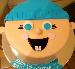 Baby face with a blue hat cake